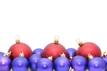 A cluster of purple and red christmas ornaments.
