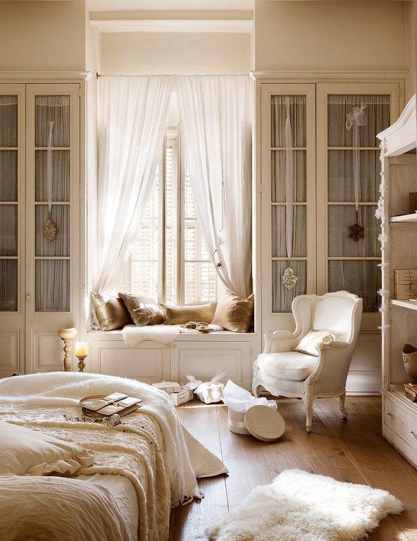 dormitorio romántico en tonos blancos