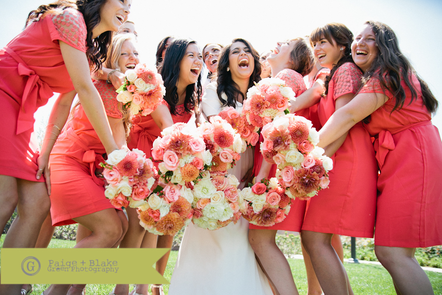 Bride and Bridesmaids laughing with bouquets : Photo by Paige and Blake Green
