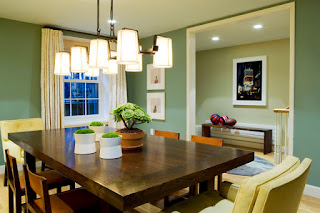 Contemporary Track Lamps on Top of Wooden Dining Room Tables And Chairs with Green Ornaments on it