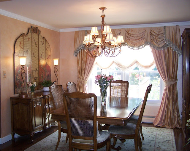 A nice dining room with a pale glazed wall and pale pink window treatments