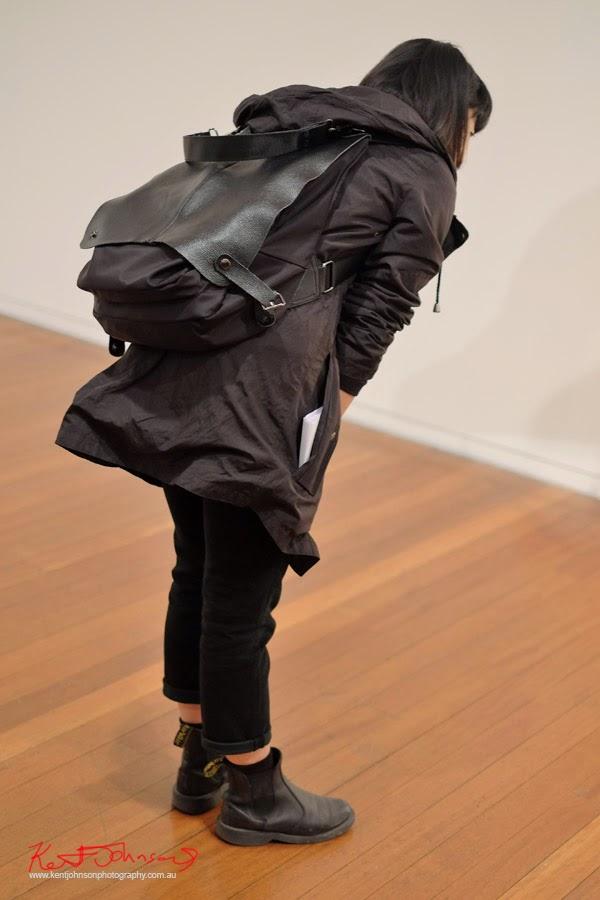 Black coat, pants and Black leather backpack/satchel - Street Fashion Sydney by Kent Johnson.