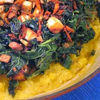 Braised greens with tofu, cashews and raisins over polenta
