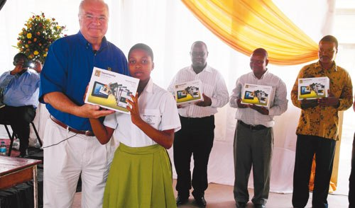 A TUTOR from the US-based Opportunity Education Foundation (OEF) Mr Lisa Beth poses with some Tusiime Secondary School teachers in Dar es Salaam on Friday, shortly after instructing them on how to use tablets for personal studies. (photo: DAILY NEWS Correspondent)