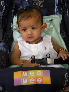 8 month baby girl in pram  by mee mee