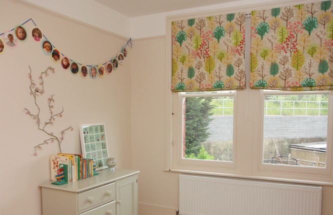 Coco's bedroom with her Spiri Haga floral tree design fabric blinds and third birthday bunting.