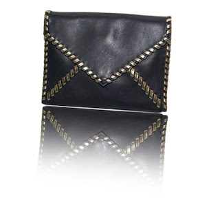 Vintage 1980's Yves Saint Laurent navy blue envelope clutch with gold whip stitch trim.