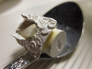metal clay ring is covered in a white coating when taken from the kiln