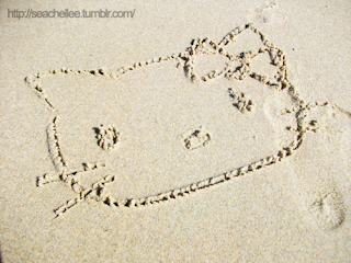 Hello Kitty Drawn In The Sand at the beach