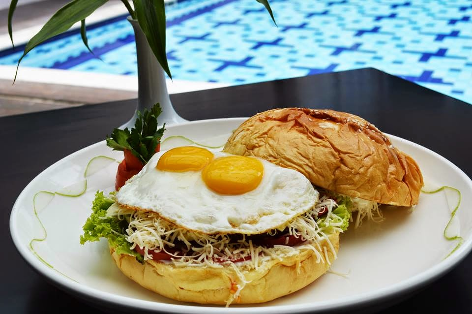 """Express Lunch Promotion"" at Horison Hotel Pematangsiantar - Big Burger:  burger bun, beef minced, onion slice, tomato slice, cucumbar slice, slice cheese, lettuce local, mayonaise, tomato sauce"