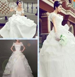 Vestido de novia corte princesa, falda con volados en capas y hombros caídos