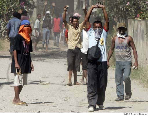HOUSES RAZED IN EAST TIMOR MOB RAMPAGE