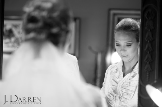 photo of the bride getting ready for her wedding at Twelve West Main in Thomasville North Carolina