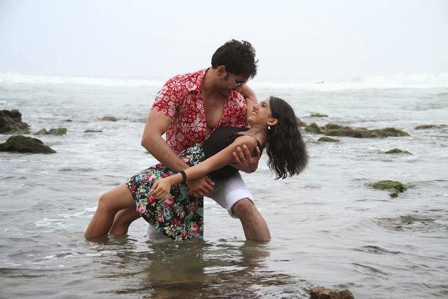 Shriya+Sharma+Ali+Reza in akudu Movie Latest Stills 5.jpg