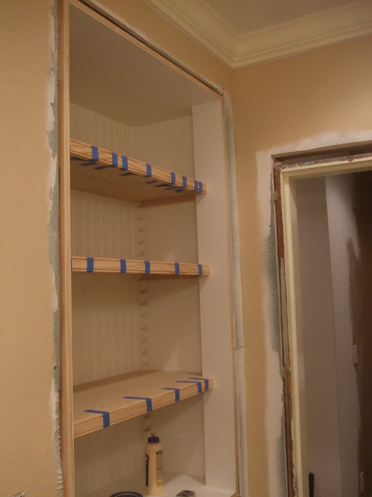 The smiths bathroom closet shelves