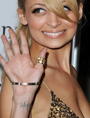 nicole richie nose job. Nicole Richie has several