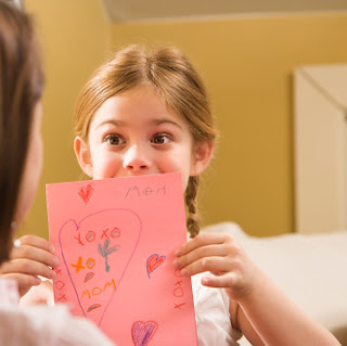 Child with mother's day card