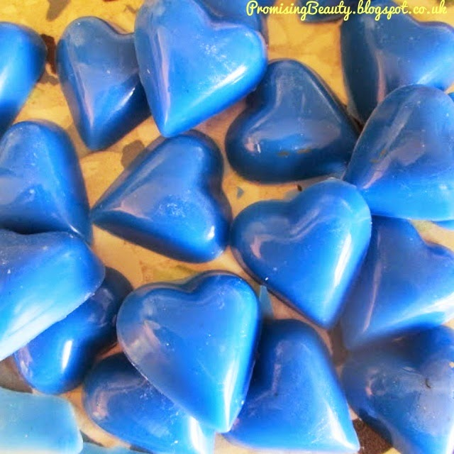 DIY blueberry wax melts in the shape of hearts. Cobalt blue.