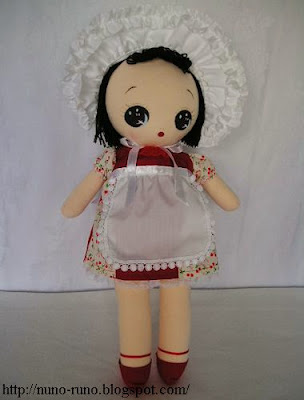 Bunka doll in red dress