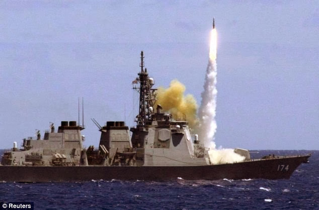 Japan's Aegis-class destroyer Kirishima launches and an anti-aircraft missile off the coast of Hawaii