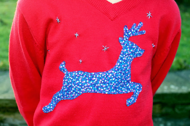 red children's jumper with reindeer applique silhouette in patterned fabric and hand stitched embroidered stars