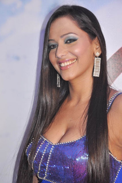 Sanjana Singh in Blue Shining top Blouse and Short Skirt