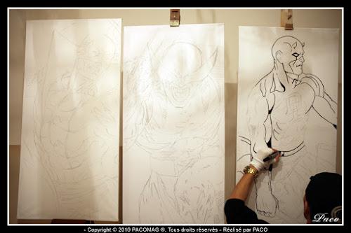 Paco illustrateur graphiste repassant le dessins de Daredevil sur toile acrylique