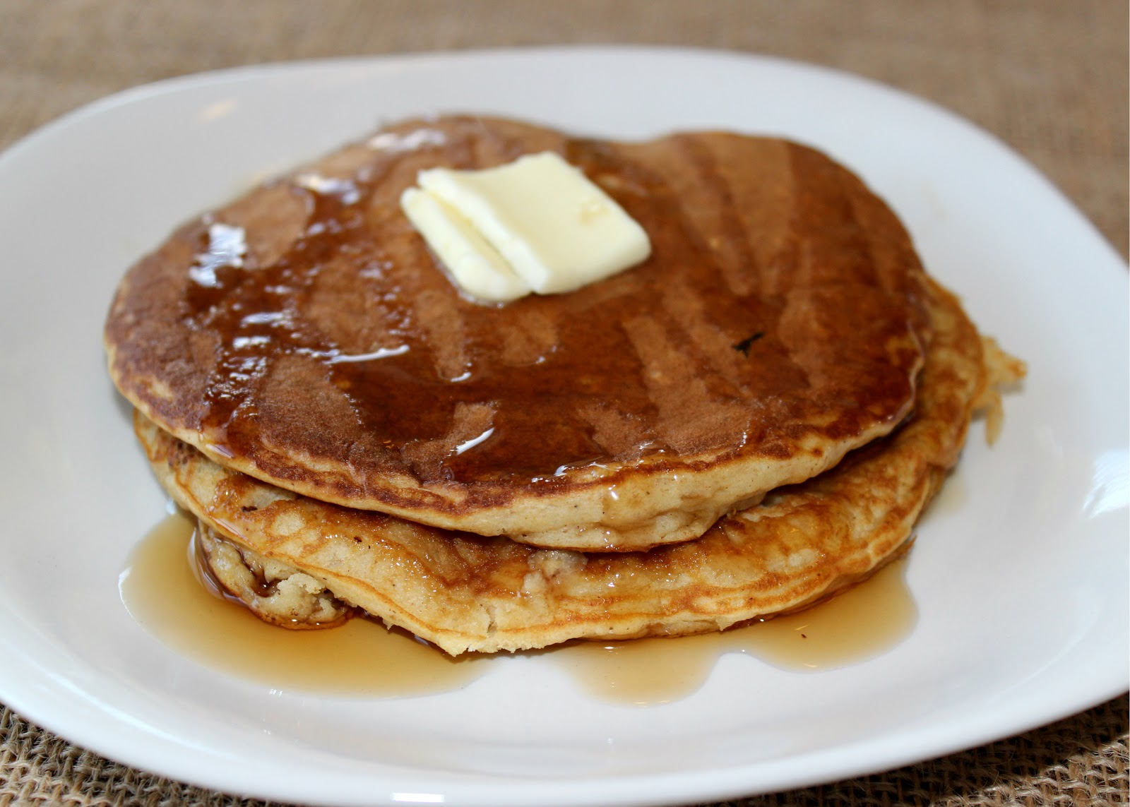 The pancakes are fluffy and airy. We drizzled them with a little bit ...