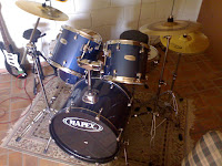 Mapex drums and old guitar