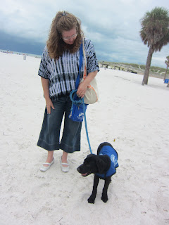 Coach gets to experience his first beach. Here he is standing beside Cheryl on the sand.