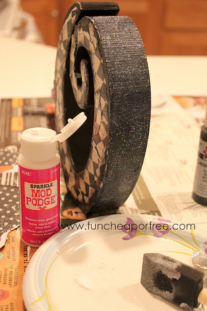 Mod Podge Sparkle on a wooden letter, from Fun Cheap or Free