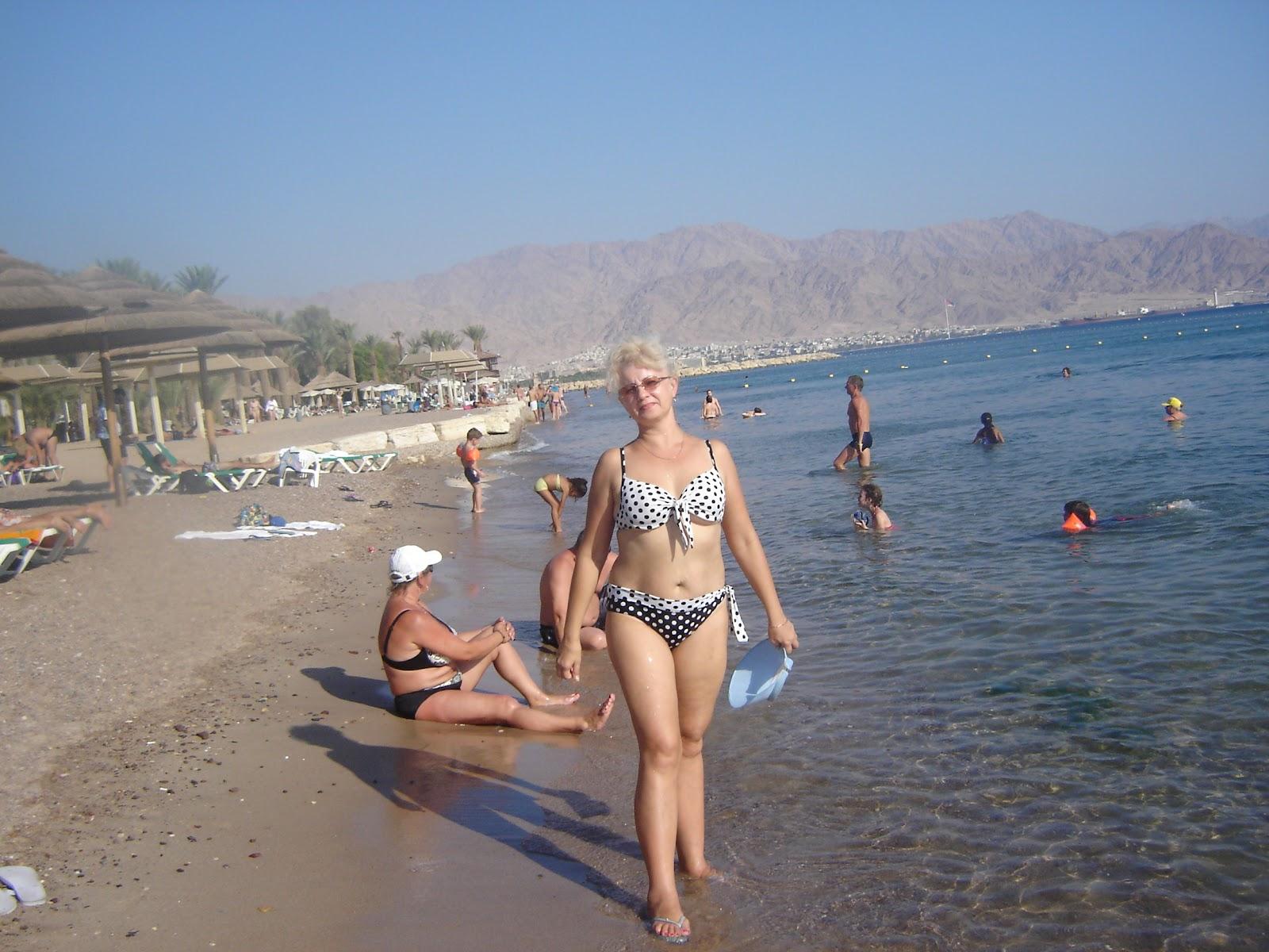 Тетя на пляже фото