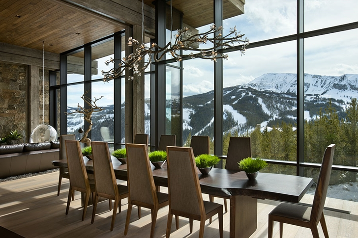 Modern dining room in Elegant Mountain Home by Reid Smith Architects