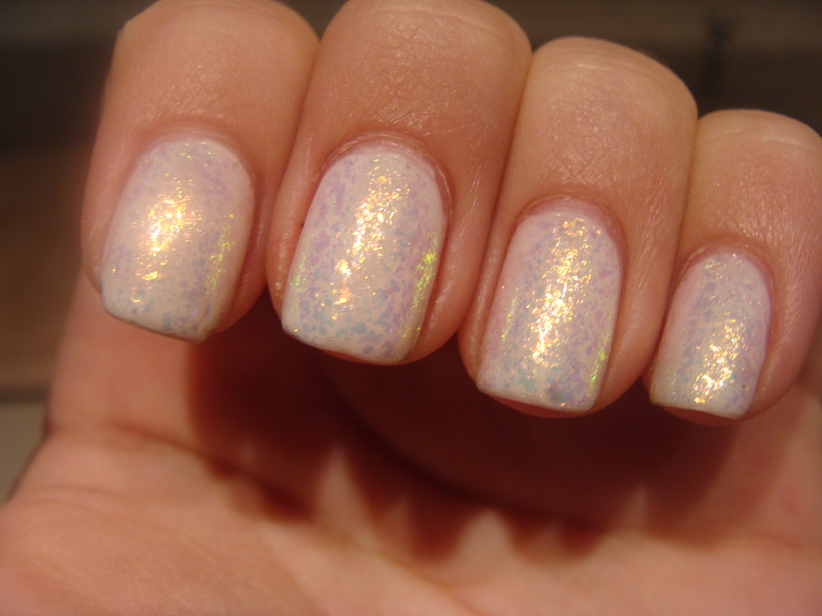 """... jellyish :D I'm in love to say the least- no VNL in two coats! I was inspired to add flakie goodness :) Enter Essie """"Shine of the Times."""" Instant opals!"""