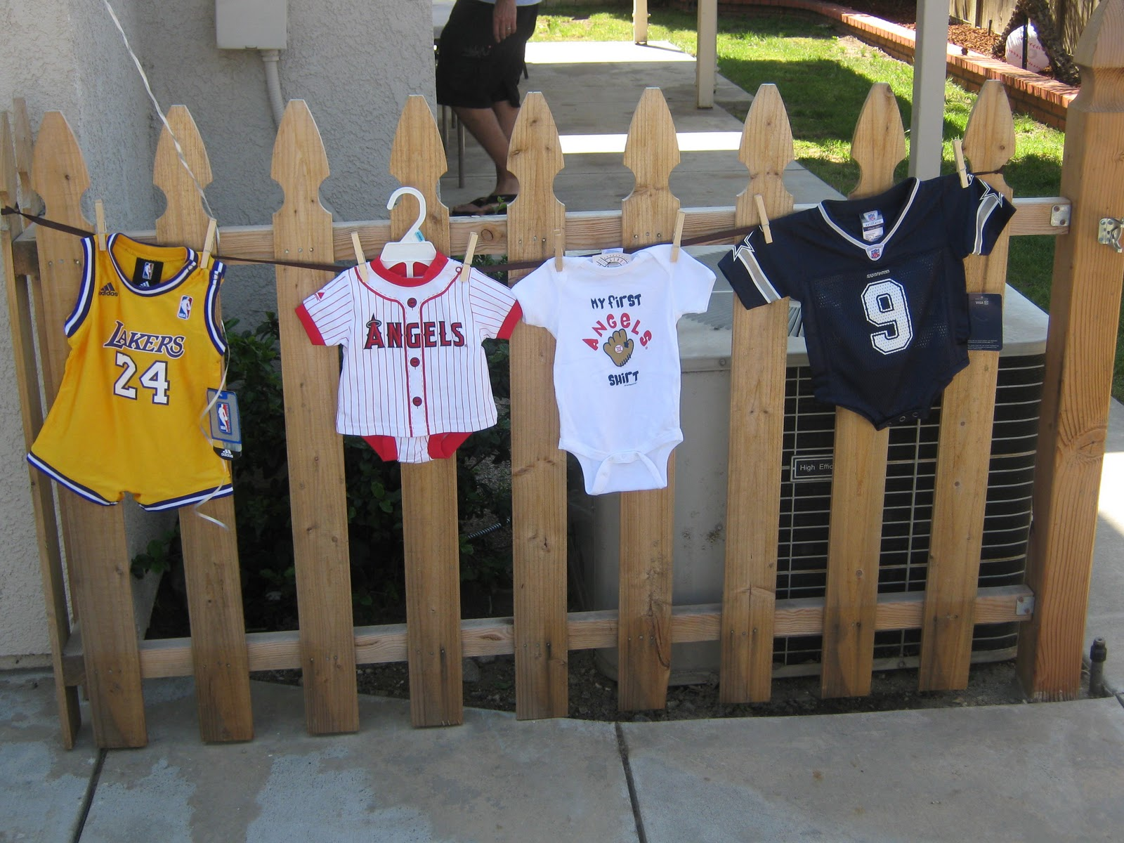 clothesline with baby clothes of the favorite sports teams of the