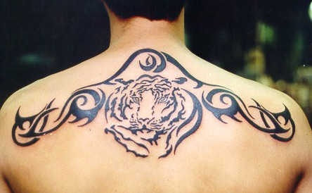 Tribal upper back tattoo with tiger head
