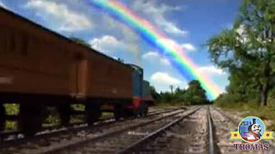 Thomas the train the end of a brilliant beautiful rainbow coloring the sky around the next corner