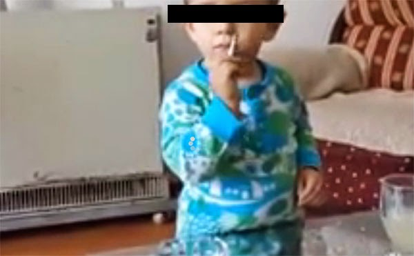 Shocking video of a 2-years old boy puffing on cigarette