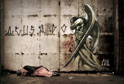 Street Art Angel homeless man sleeping