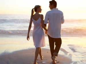 Love On A Walk: A Real Love Story - two lovers walking on a beach sand