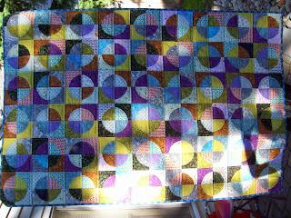 http://coolerquilts.blogspot.com/2014/06/raw-edge-circles-quilt-aka-drunkards.html