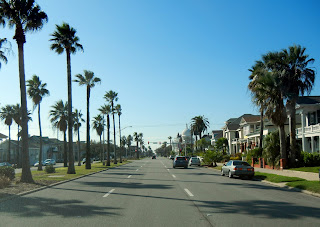Driving on Broadway Avenue in Galveston, TX
