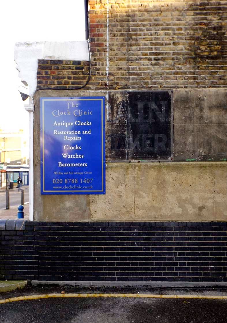 undertaker ghost sign clock clinic putney
