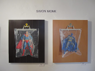 Simon Monk Superheros in bags at Aqua Art Fair, Miami 2012