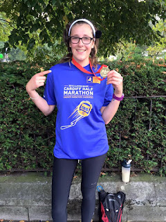 Mandi Brooks with my medal and T-Shirt at the Cardiff Half Marathon