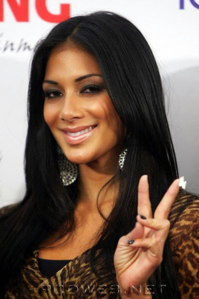 Nicole Scherzinger wearing Jenny Dayco earrings