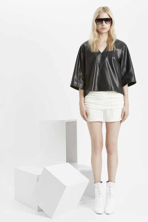 Shinny black jacket, white skirt, sunglasses and white long shoes for ladies