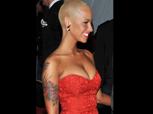 Picture Of Amber Rose Showing Her Wrist And Thigh Tattoos Amber Rose