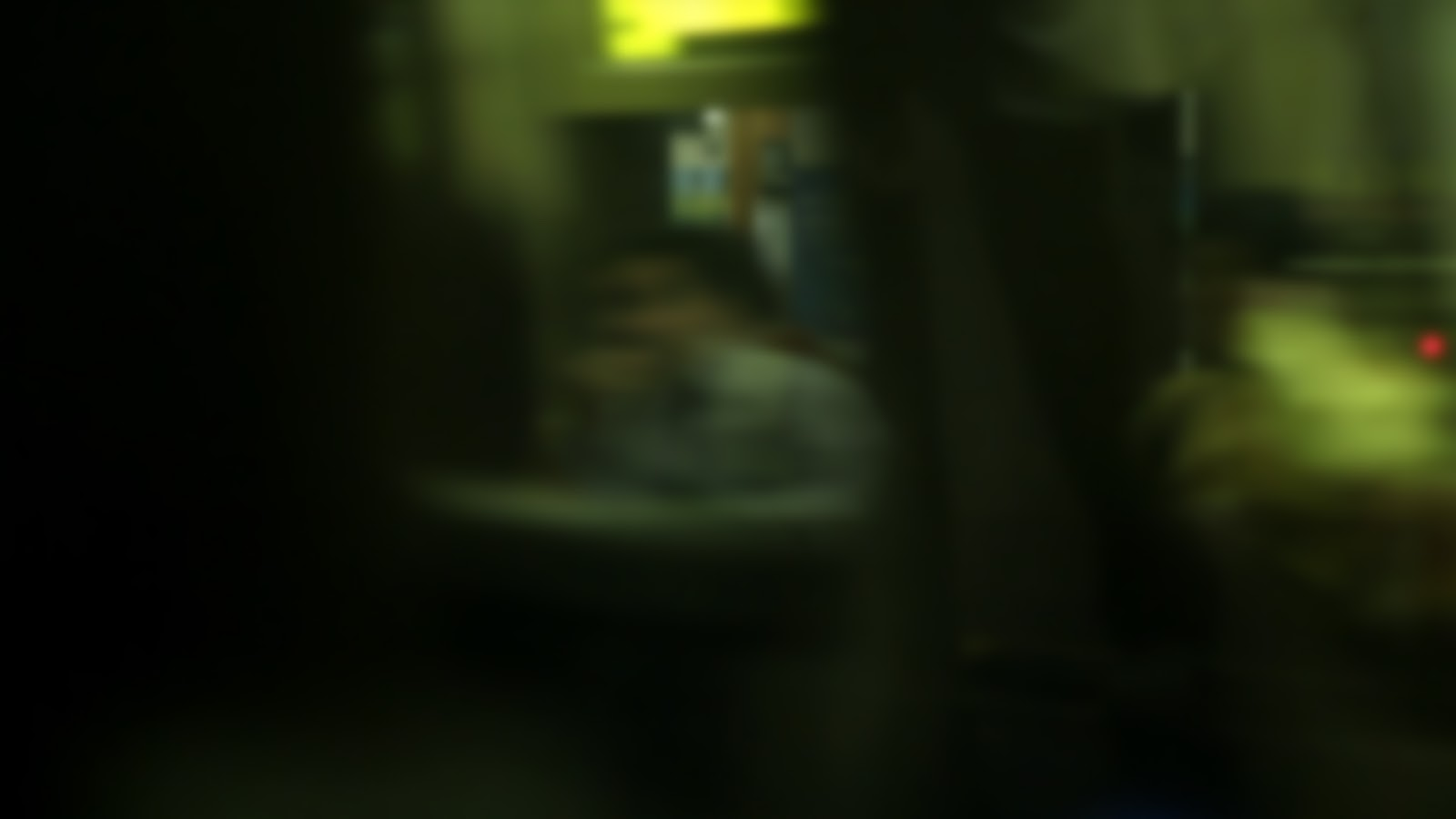 An out of focus (blurry) image of a subway car speeding by.  Focus is due to motion blur.