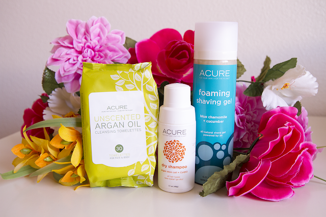 Photo of Acure cleansing towelettes, Acure dry shampoo, Acure shaving gel.